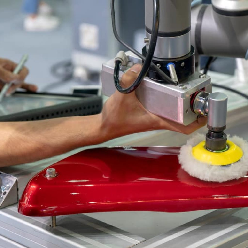 Photo: Engineer performing buffing operation on an automotive part